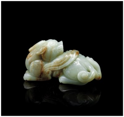 A CELADON JADE CARVING OF A QI