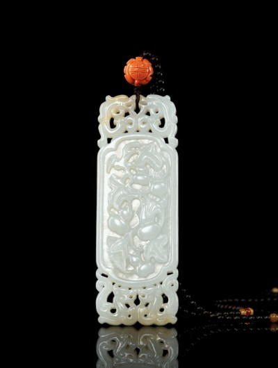 A RETICULATED WHITE JADE PLAQU