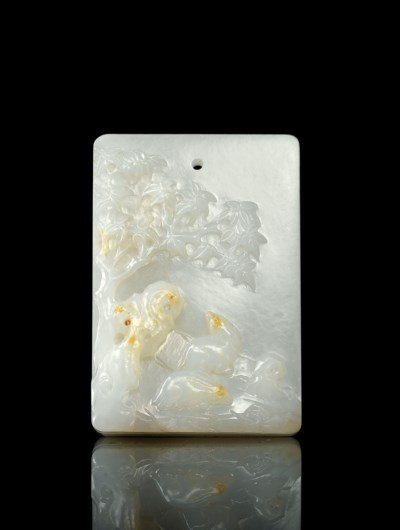 A WHITE JADE 'RABBITS' PLAQUE