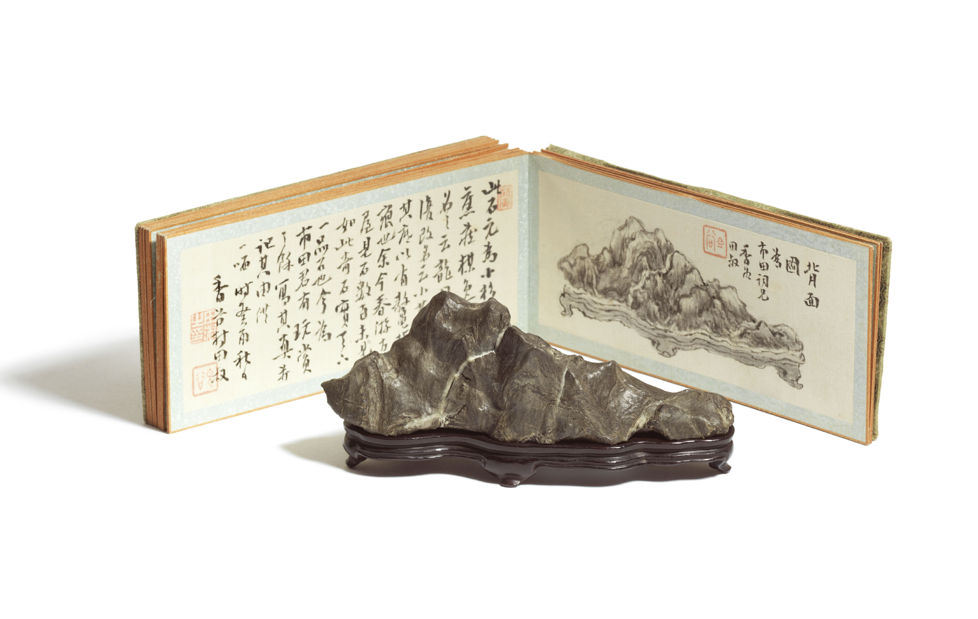 A SMALL JAPANESE FURUYAISHI ROCK MOUNTAIN ACCOMPANIED WITH A MOUNTED ALBUM OF COMMENTARIES BY VARIOUS CONNOISSEURS