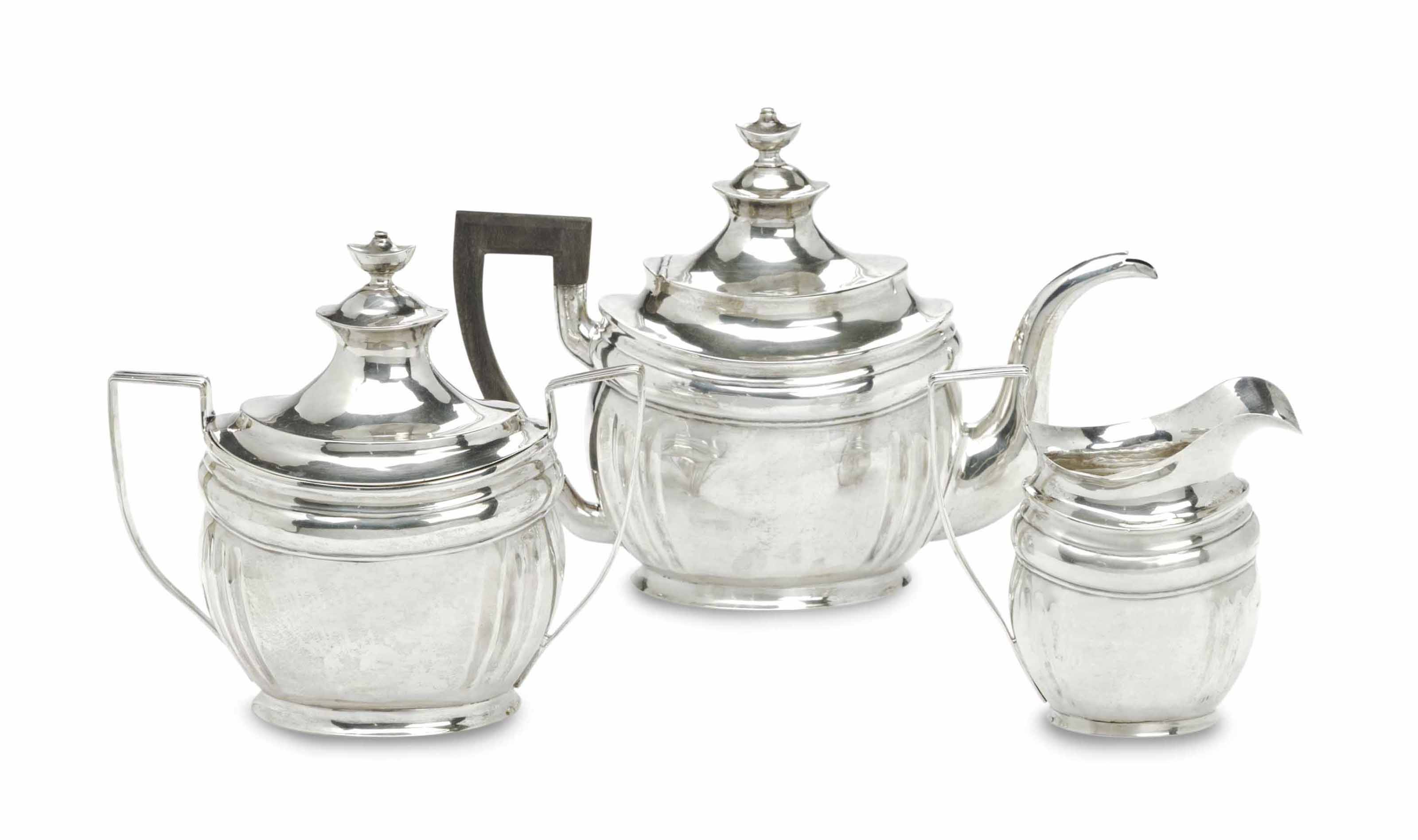 AN EARLY AMERICAN SILVER THREE-PIECE TEA SERVICE,
