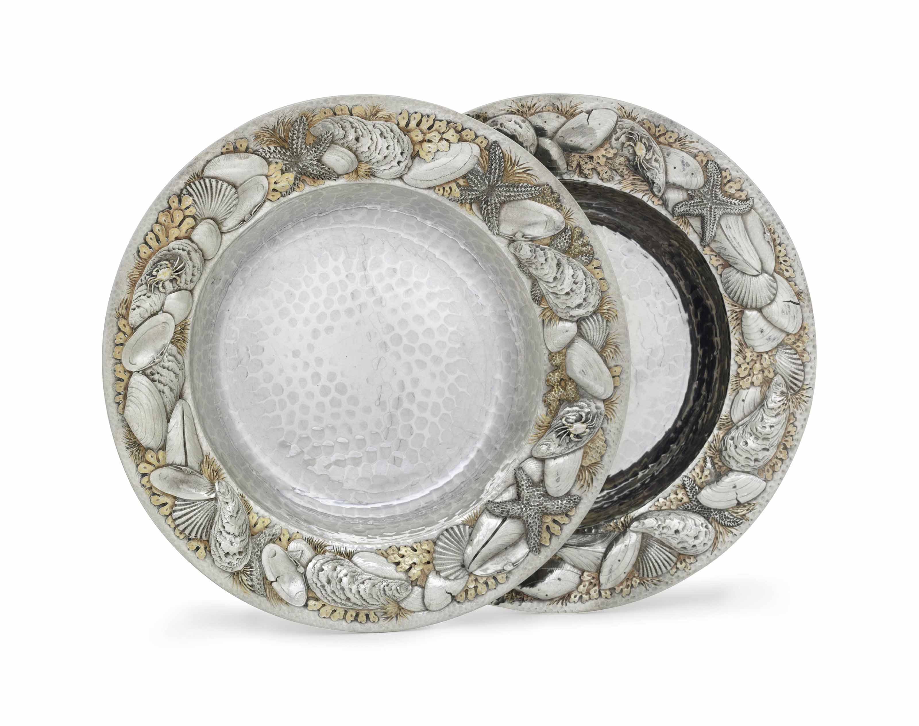 A PAIR OF PARCEL-GILT SILVER DISHES
