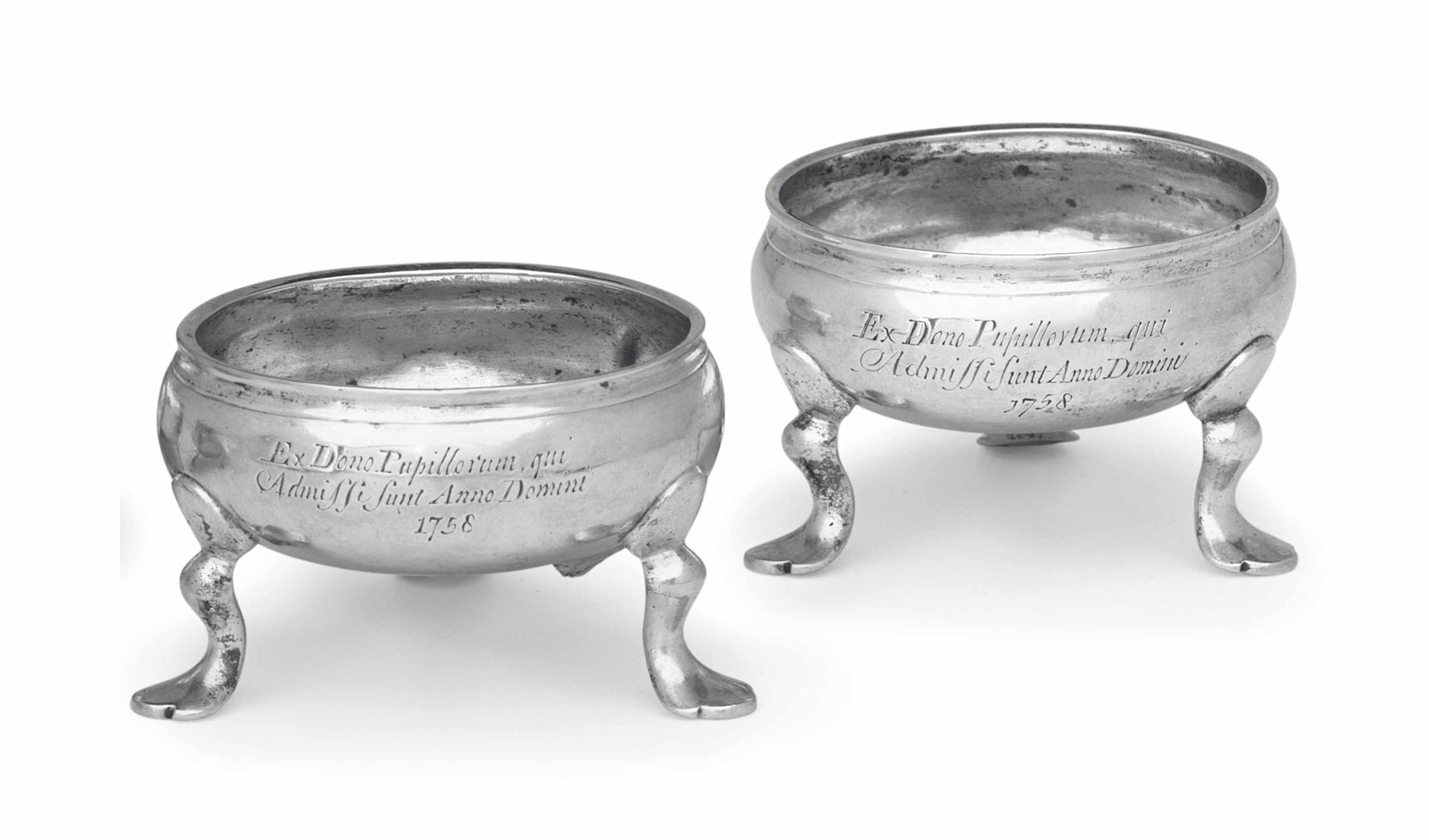 A PAIR OF 'TUTORIAL' SILVER SALT CELLARS