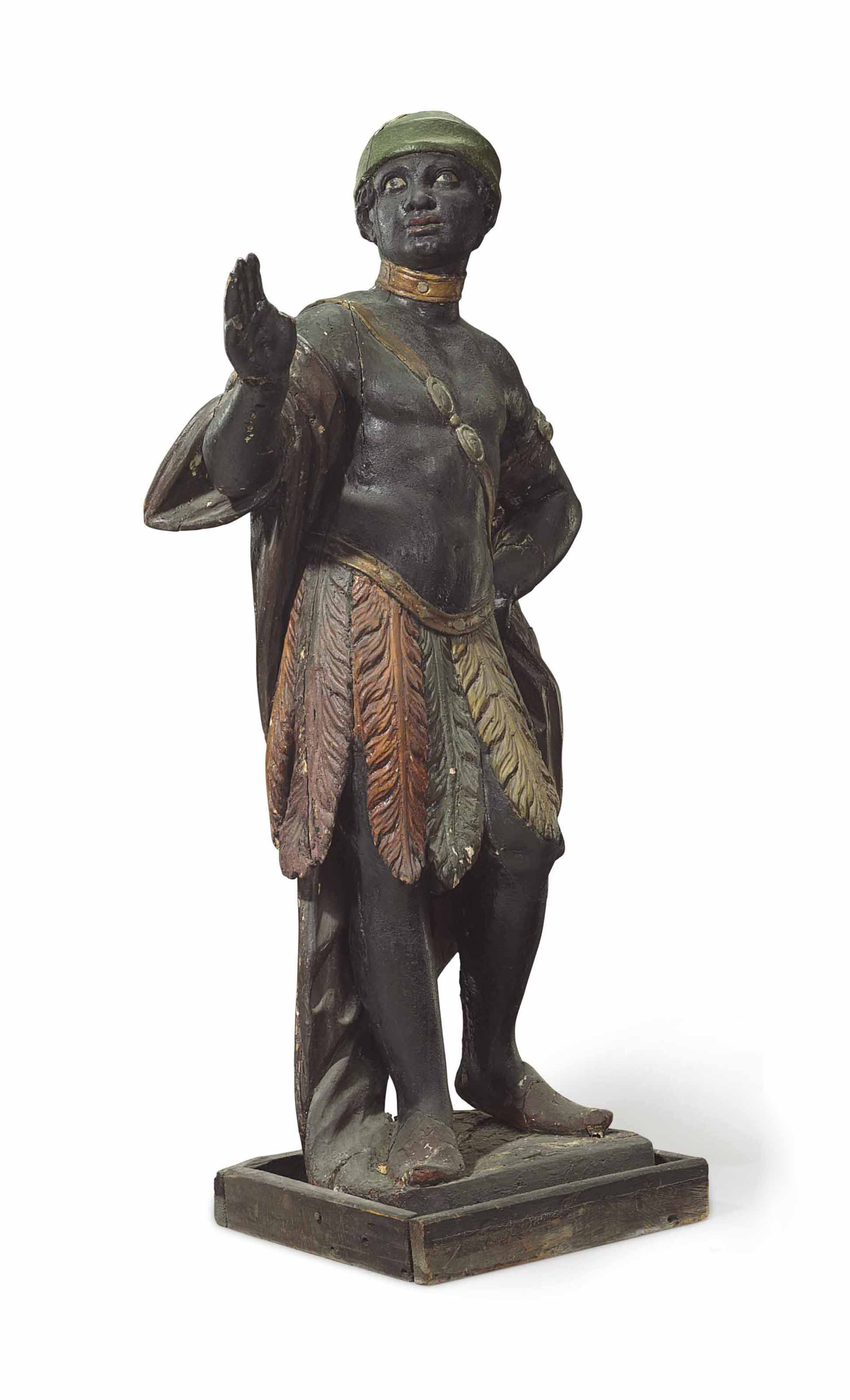 A CARVED, PAINTED AND POLYCHRO