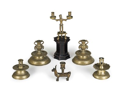 A GROUP OF CAST BRASS CANDLEST