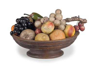 A GROUP OF CARVED STONE FRUIT