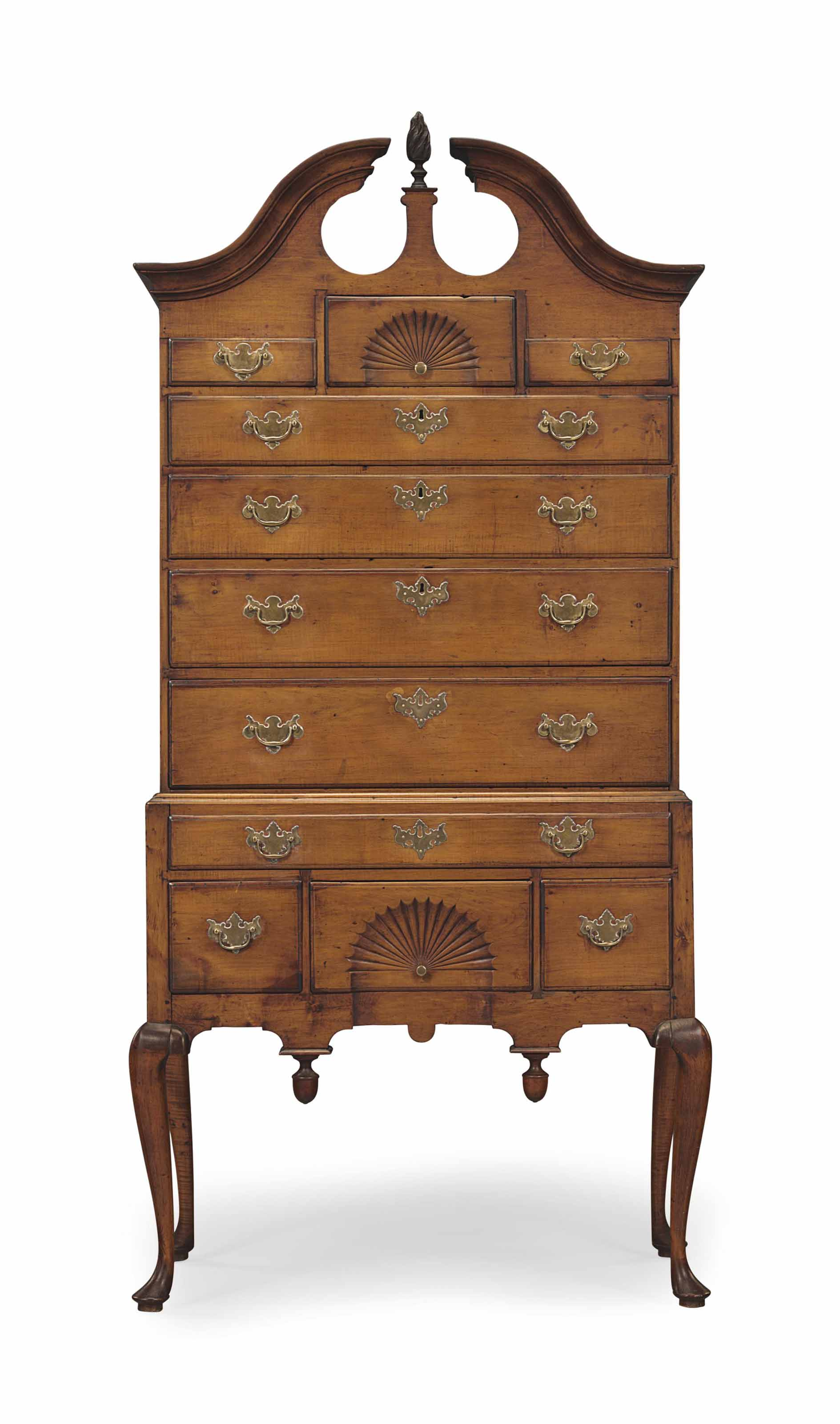A queen anne carved and figured maple high chest of