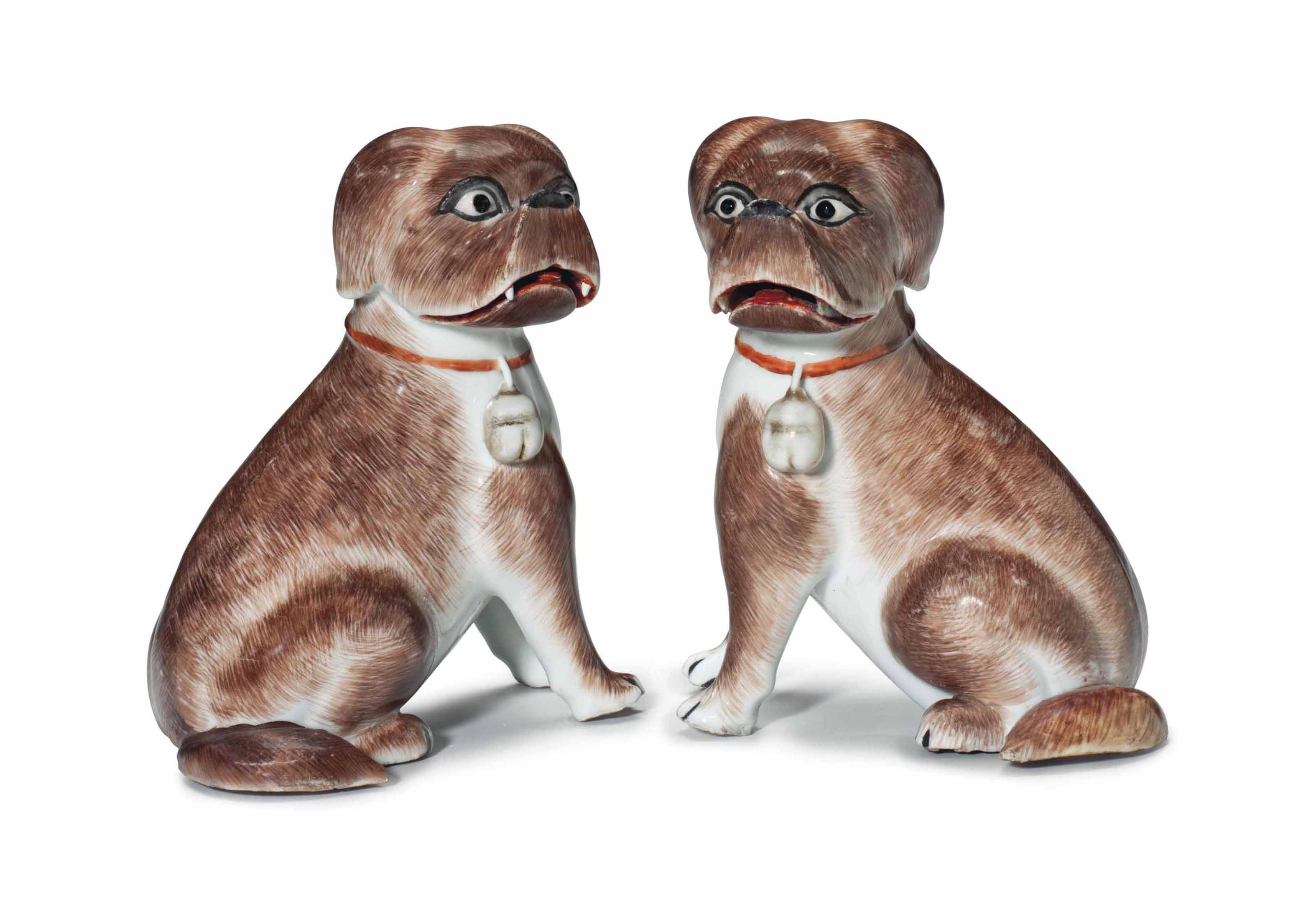 A PAIR OF SEATED PUG DOGS