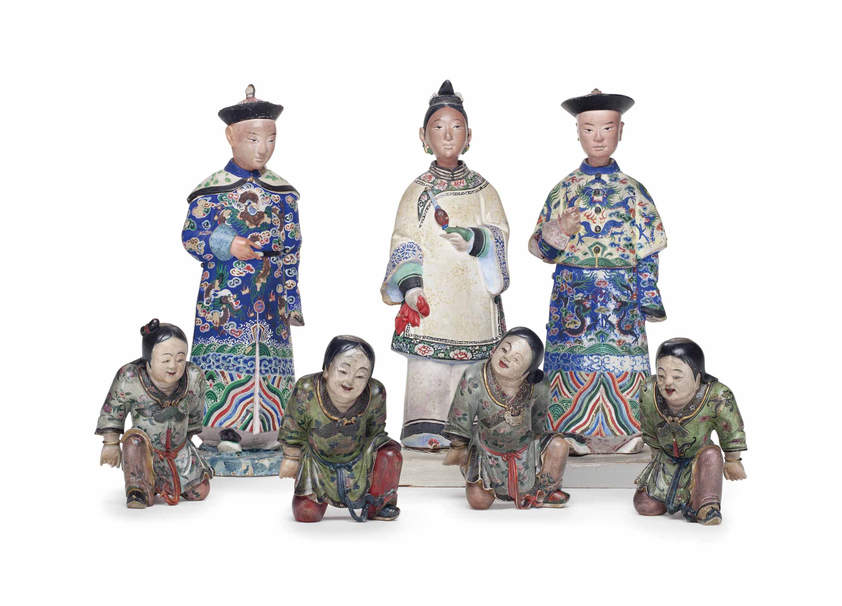 A GROUP OF SEVEN CARVED AND PA