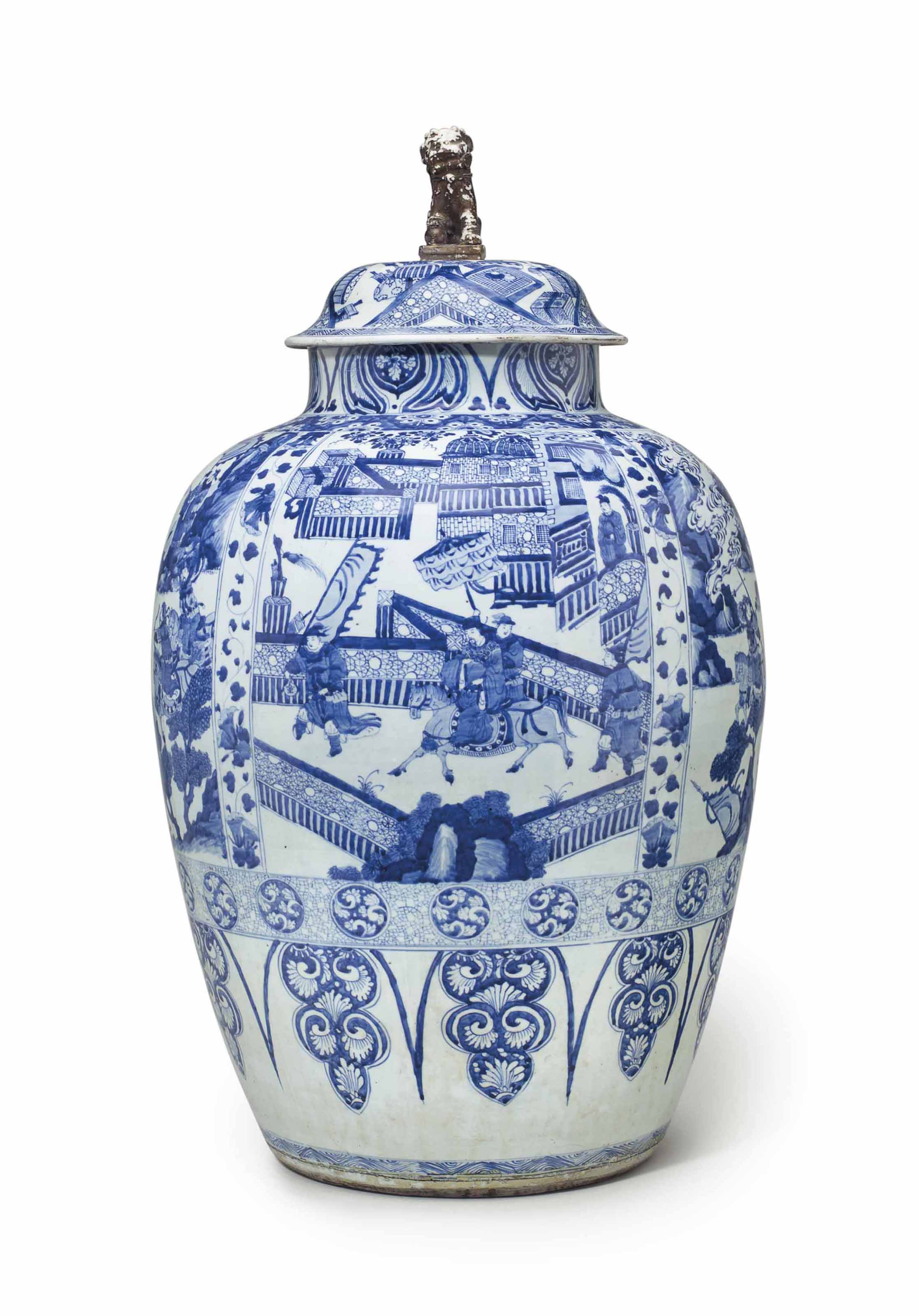 A MASSIVE BLUE AND WHITE JAR AND A COVER