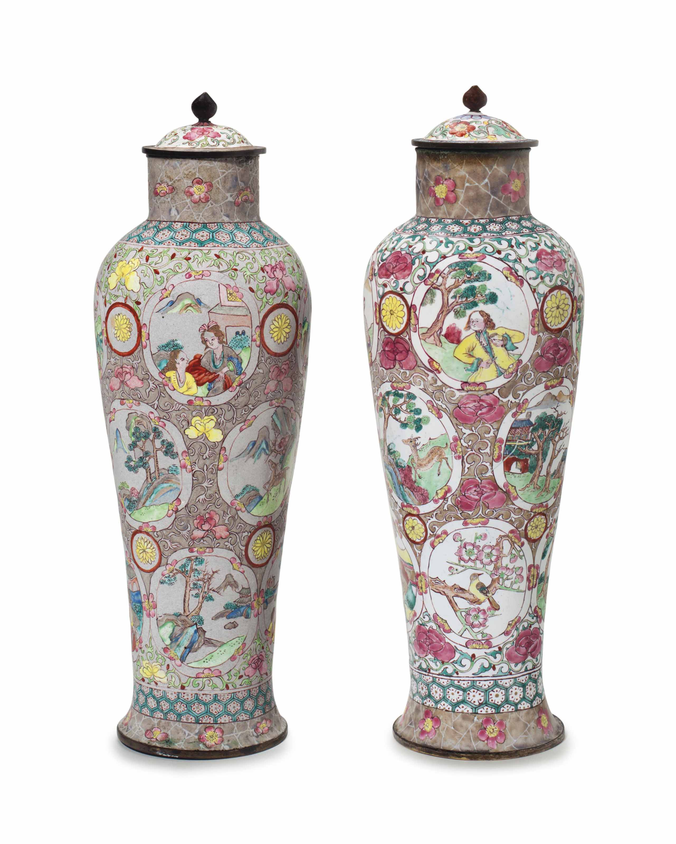 AN UNUSUAL PAIR OF ENAMEL VASES AND COVERS