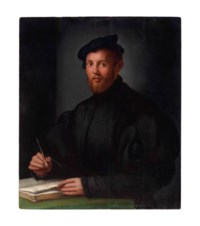 Portrait of a young man with a book