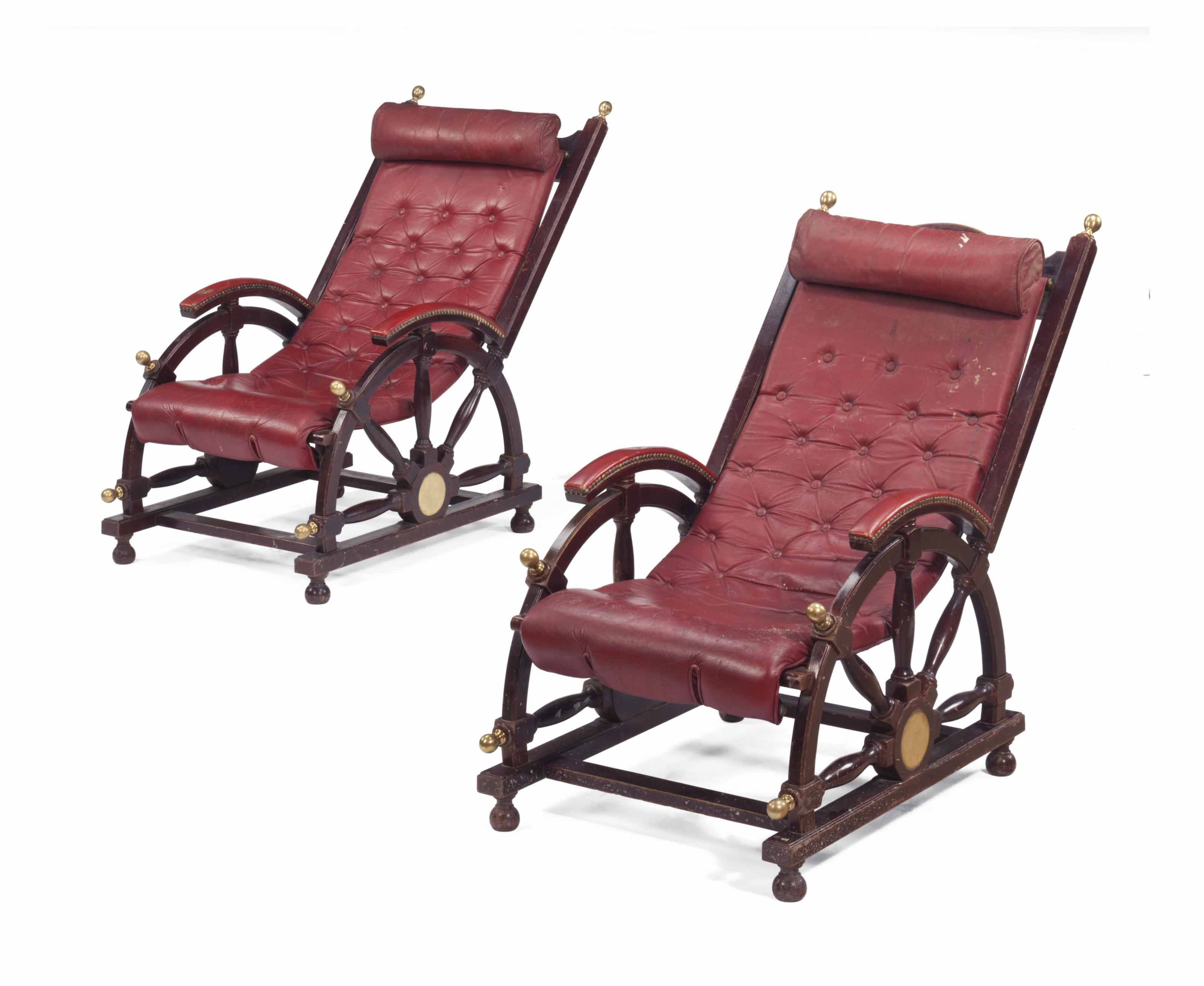 A PAIR OF BRASS-MOUNTED AND RED-LEATHER DECK-CHAIRS,