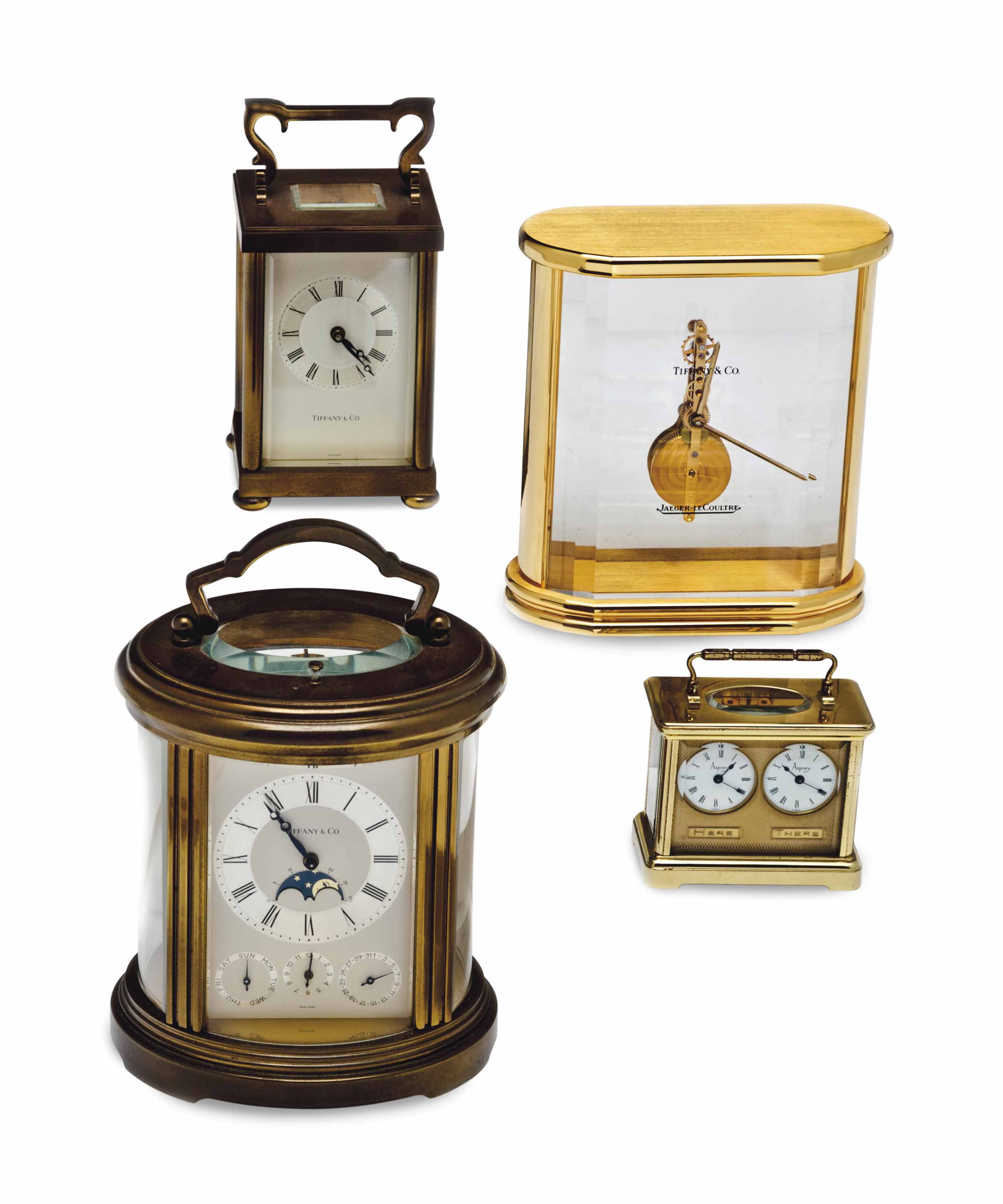 A GILT-BRASS TABLE CLOCK AND T