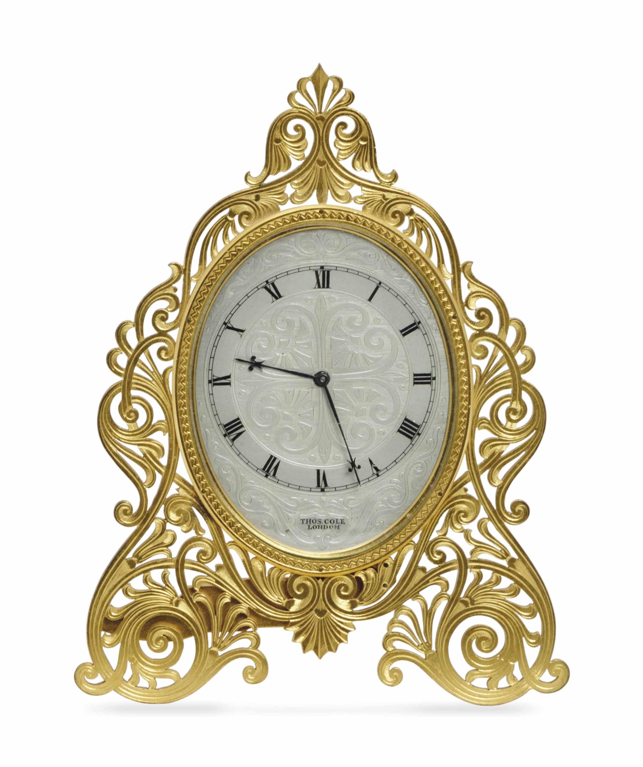 AN ENGLISH ENGRAVED GILT-BRASS STRUT TIMEPIECE,