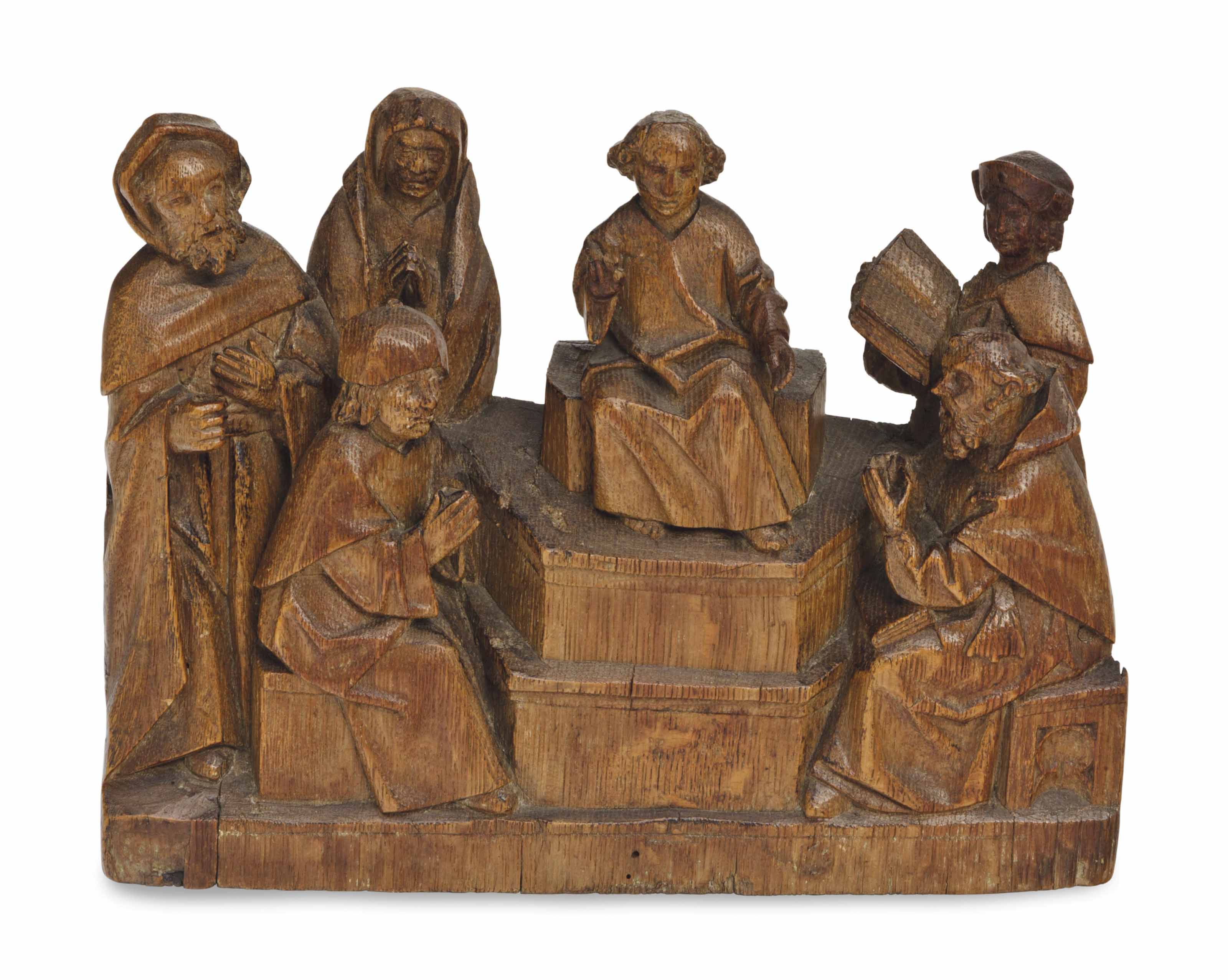 A FLEMISH CARVED OAK RELIEF OF