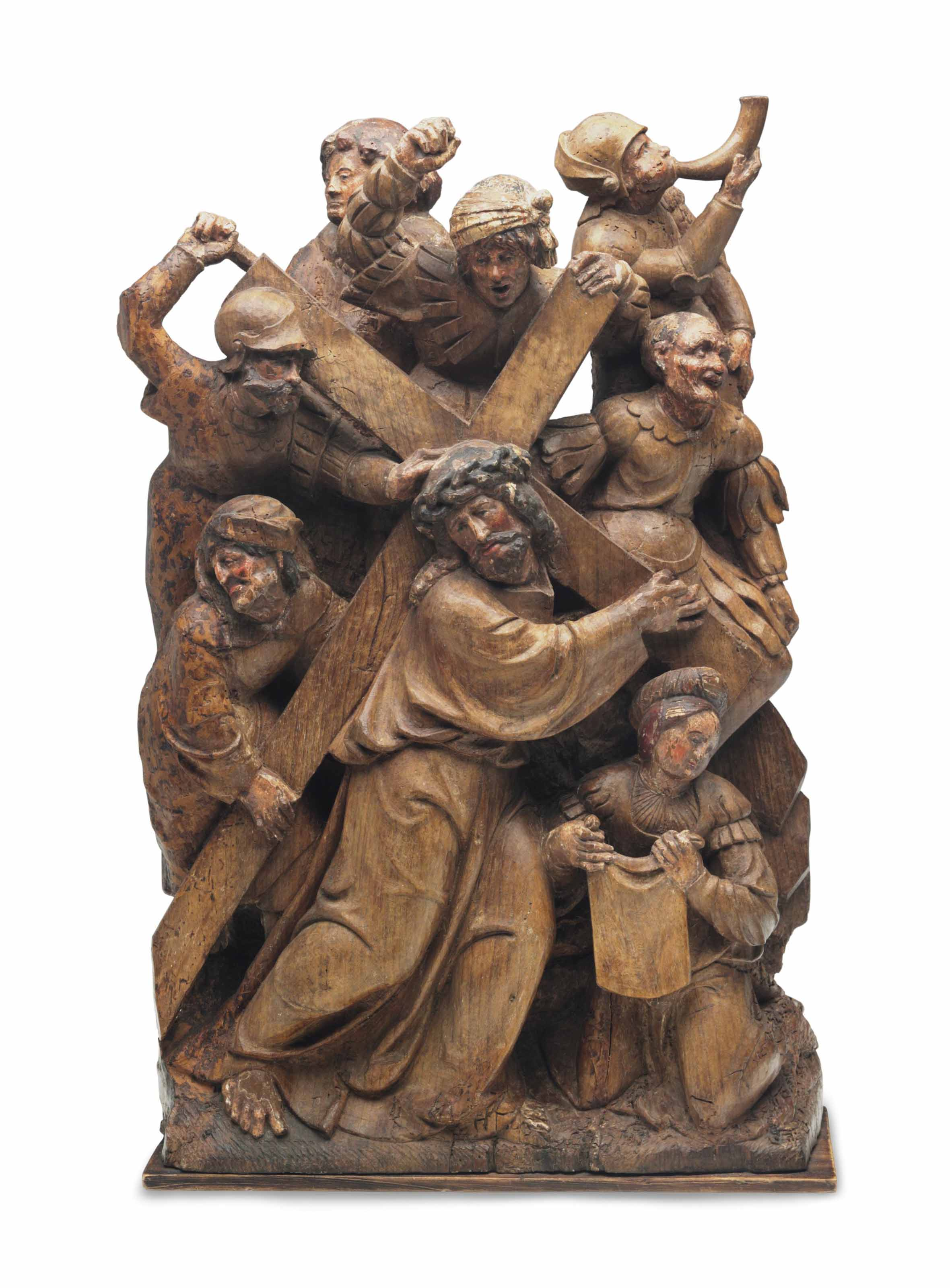 A carved oak relief of christ bearing the cross