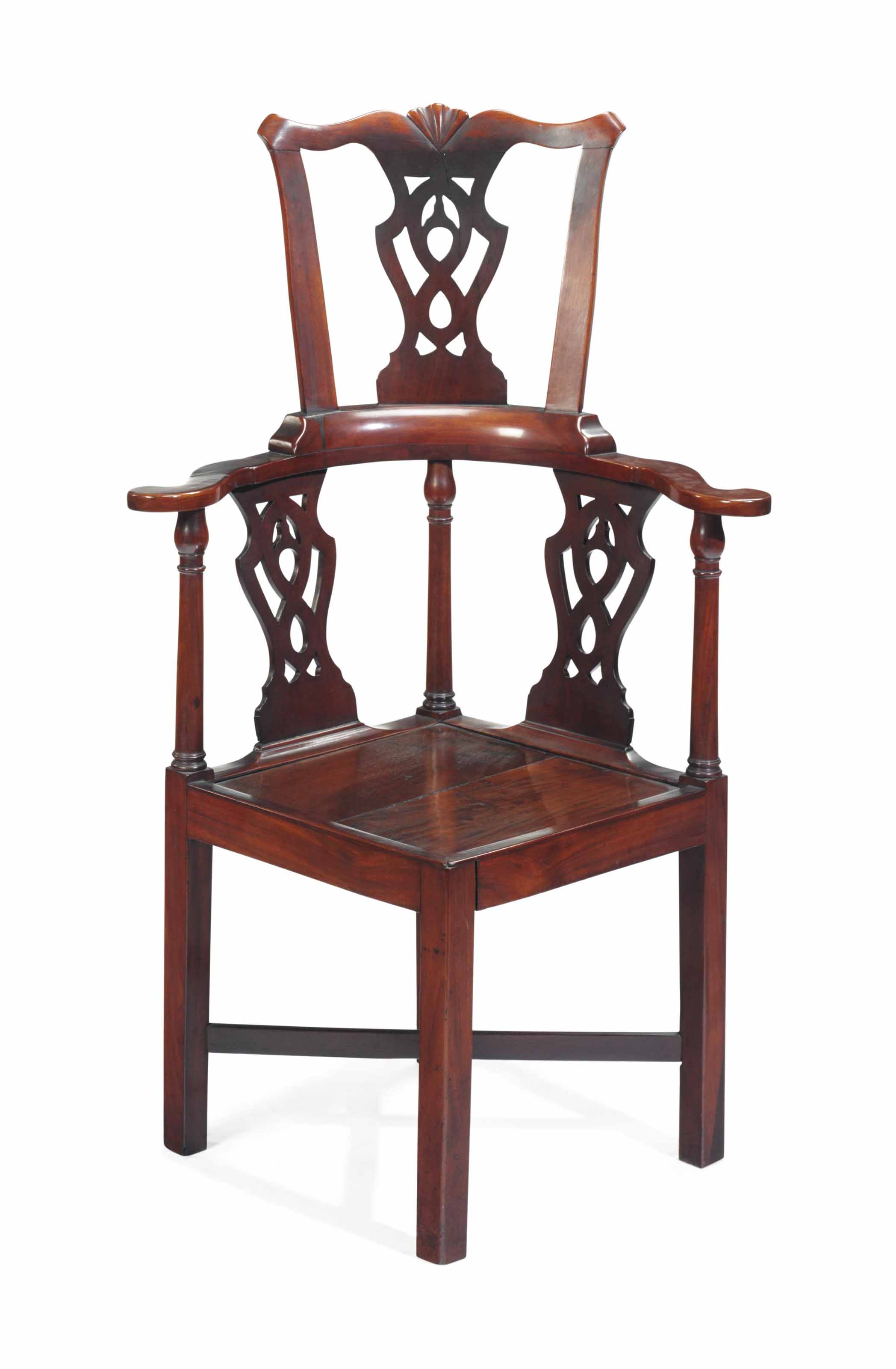 A MAHOGANY ROUNDABOUT CHAIR