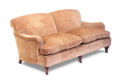 A TWO-SEAT SOFA COVERED IN BRO