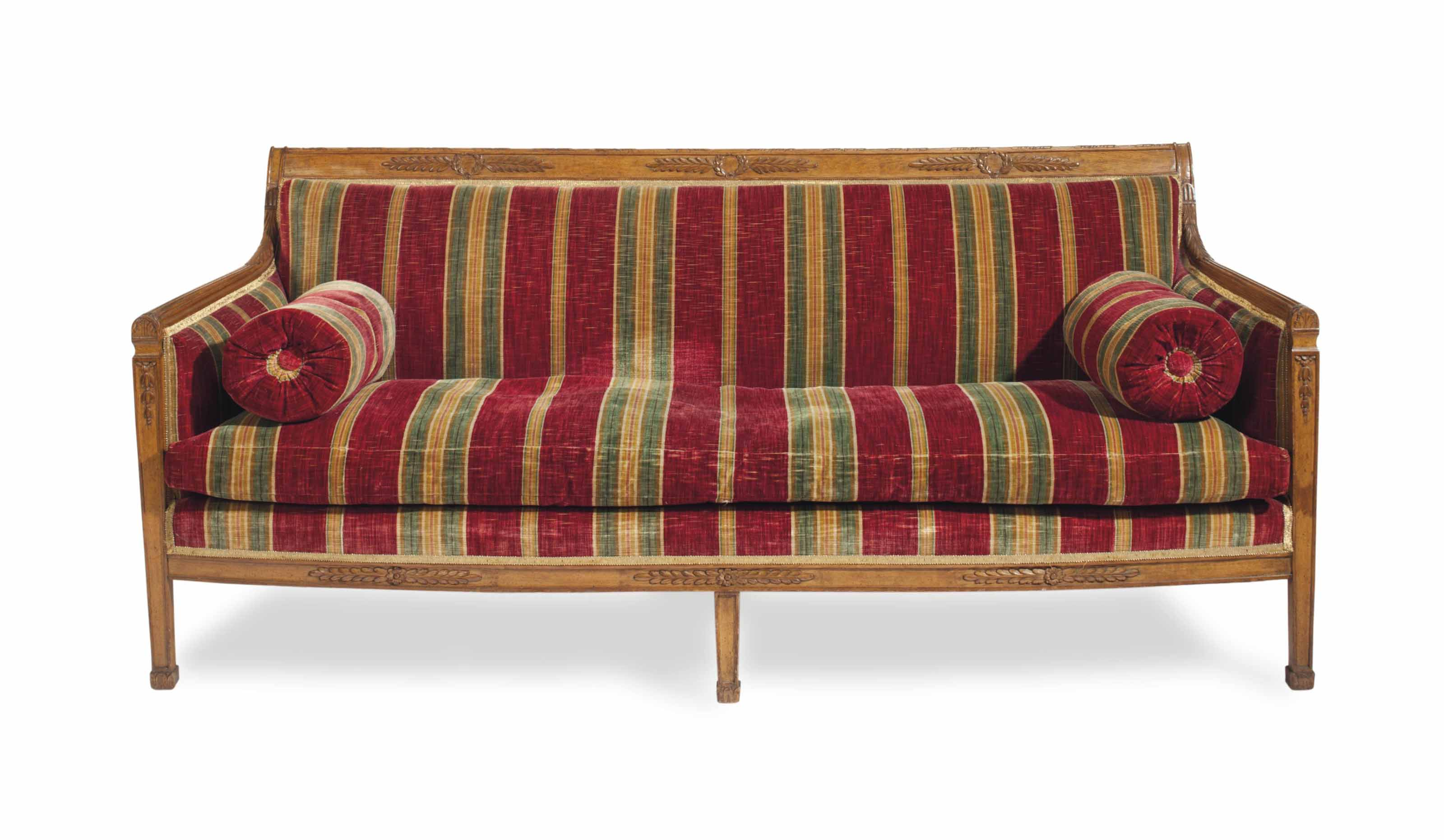 A STAINED OAK SOFA COVERED IN