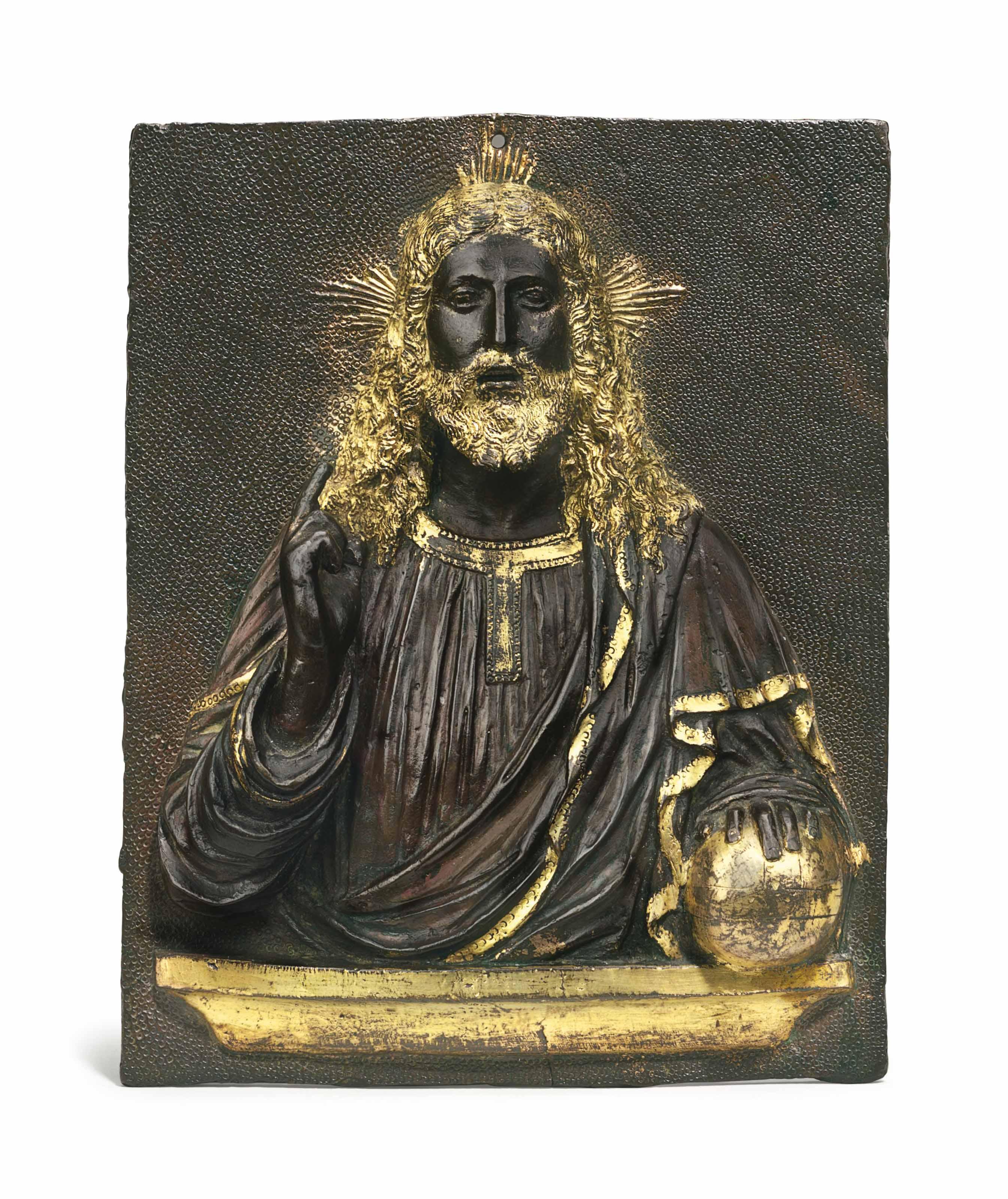 A PARCEL-GILT RECTANGULAR BRONZE RELIEF OF CHRIST AS SALVATOR MUNDI