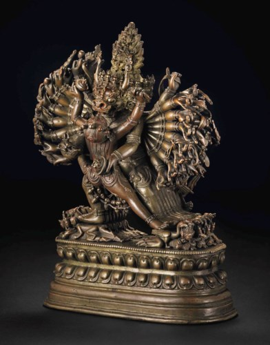 AN EXCEPTIONAL BRONZE FIGURE O