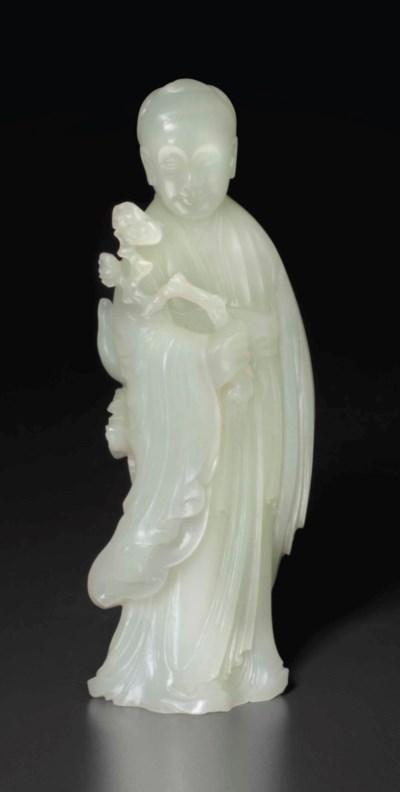 A WHITE JADE FIGURE OF A FEMAL