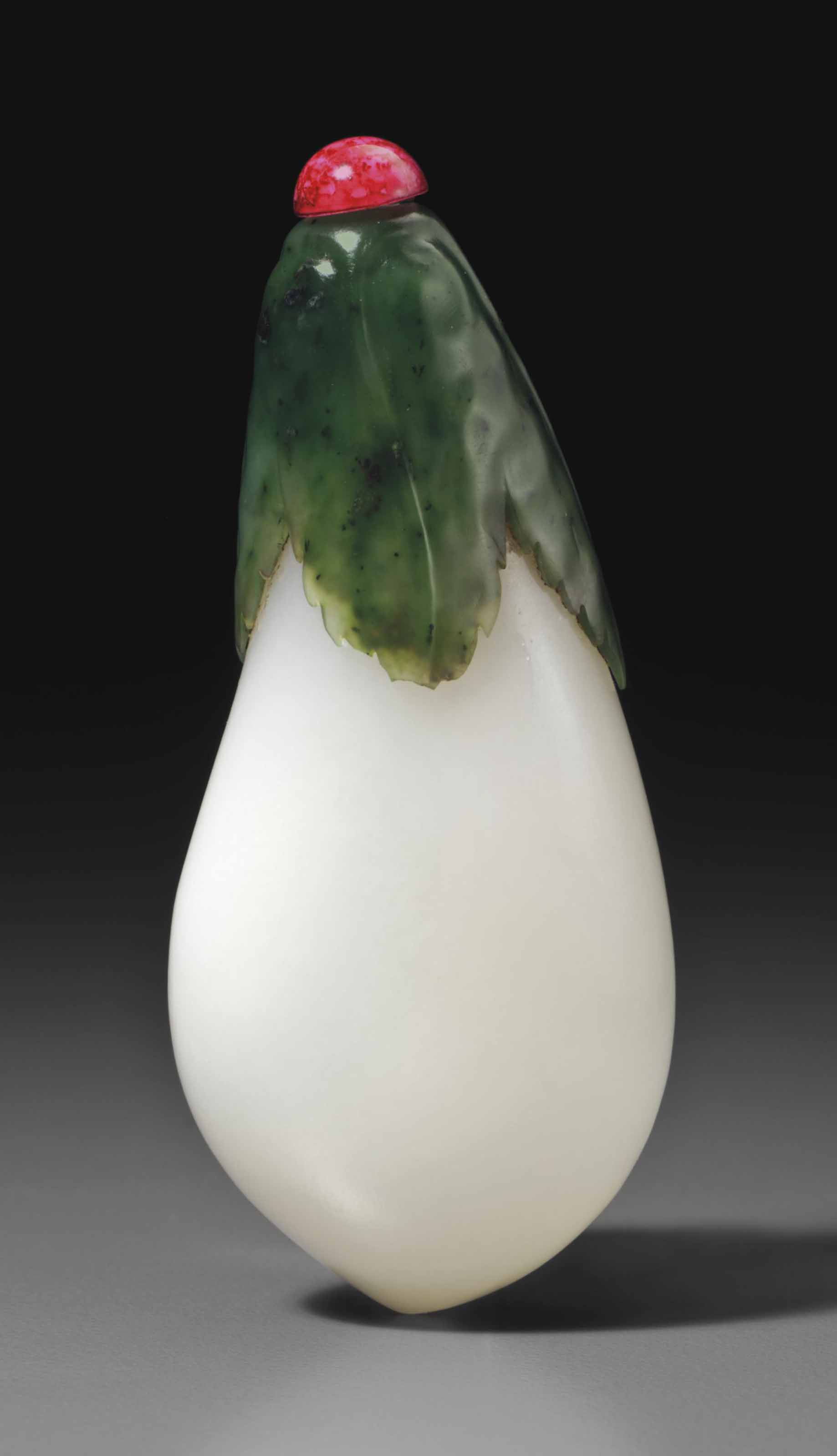 A WHITE AND GREEN JADE EGGPLAN