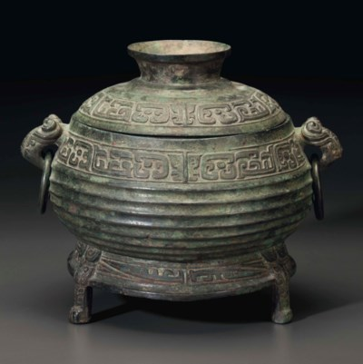 A BRONZE TRIPOD FOOD VESSEL AN