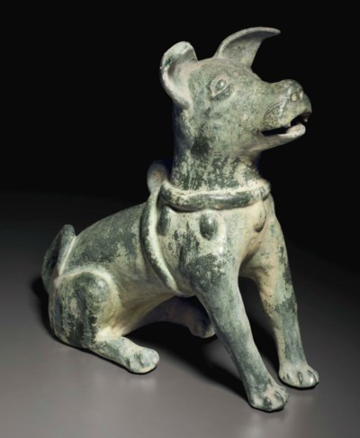 A GREEN-GLAZED RED POTTERY FIG