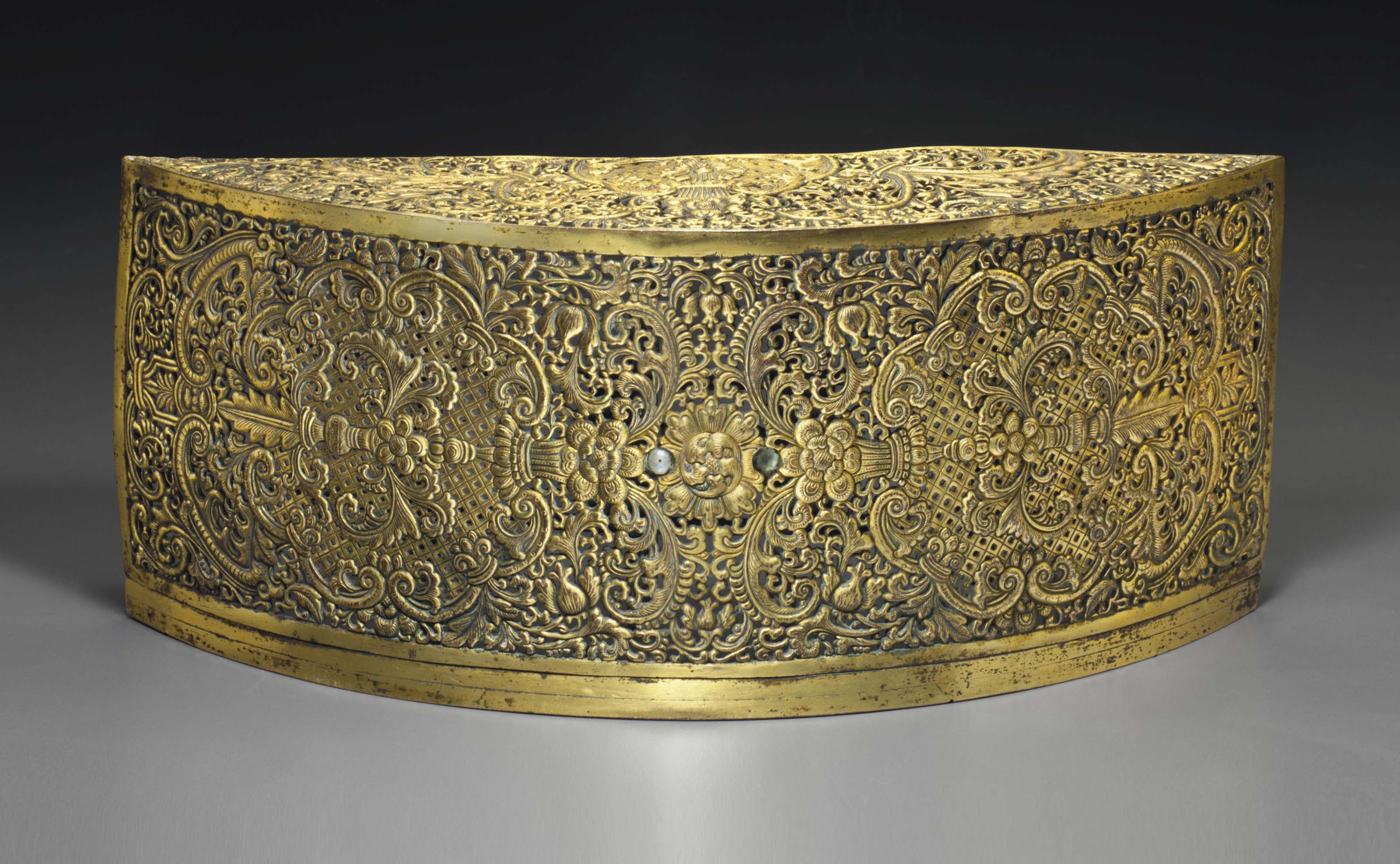 A GILT-BRONZE GILT-COPPER RETI