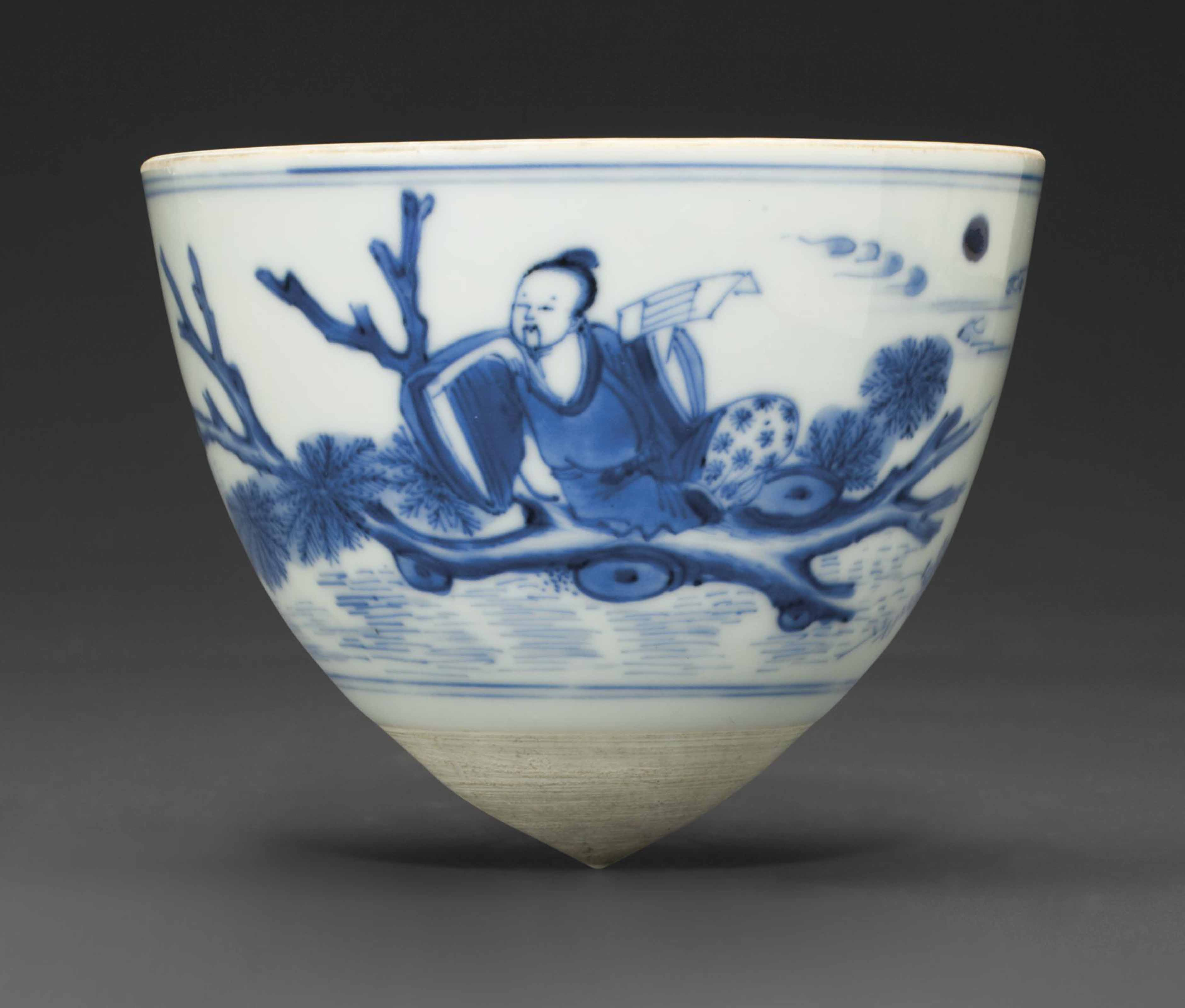 A BLUE AND WHITE CONICAL CUP