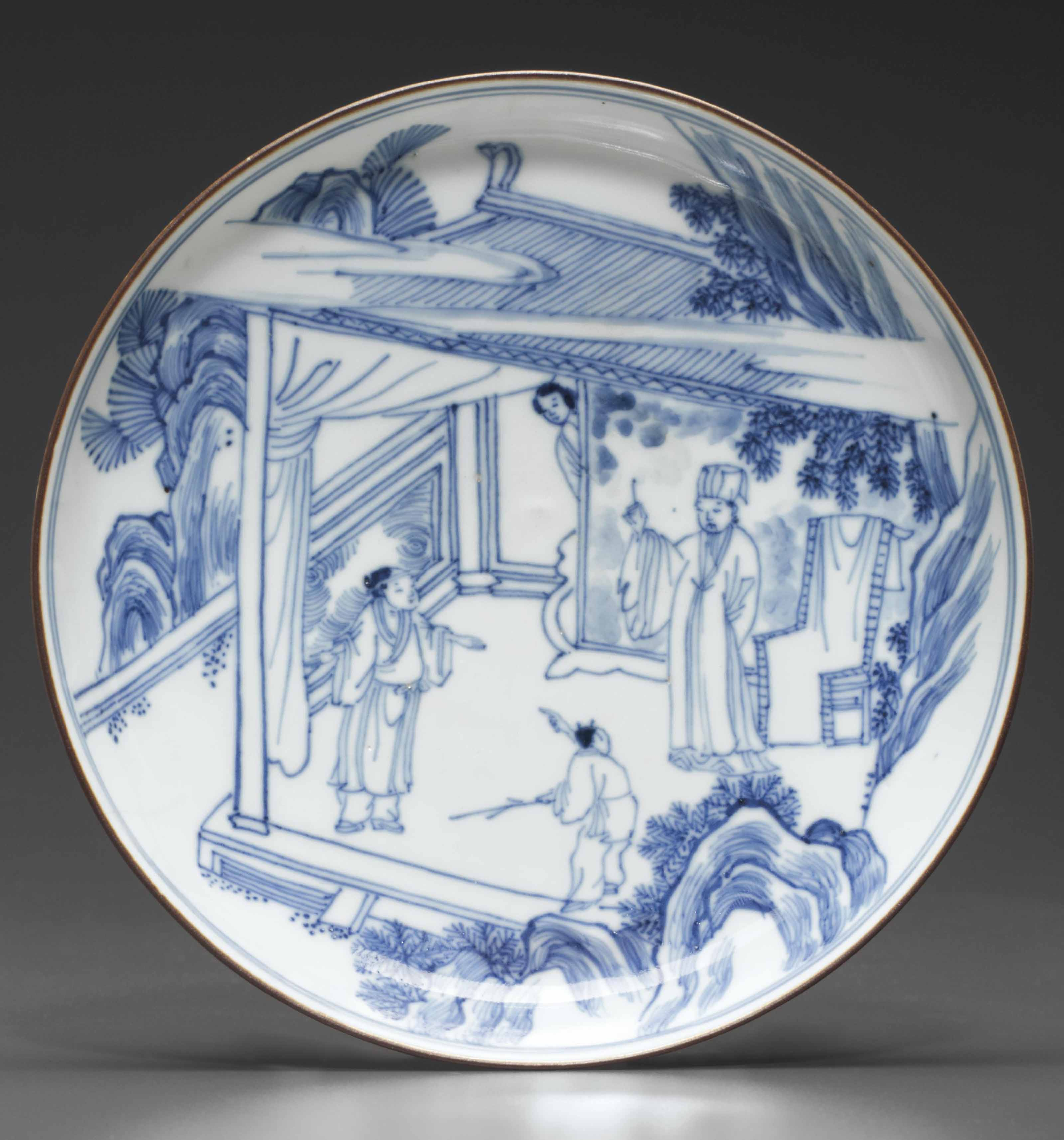 A BLUE AND WHITE SHALLOW BOWL