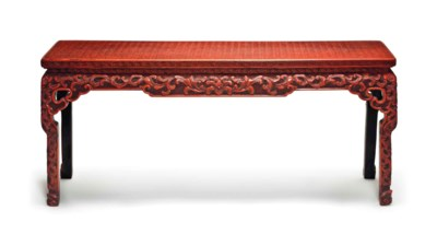 A RED LACQUER CORNER-LEG TABLE