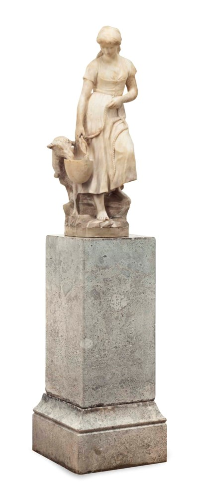 AN ALABASTER FIGURAL GROUP OF