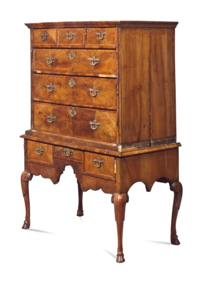 A QUEEN ANNE WALNUT CHEST-ON-S