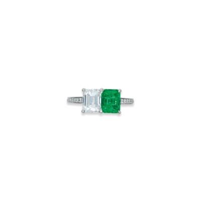 A DIAMOND AND EMERALD TWIN-STO