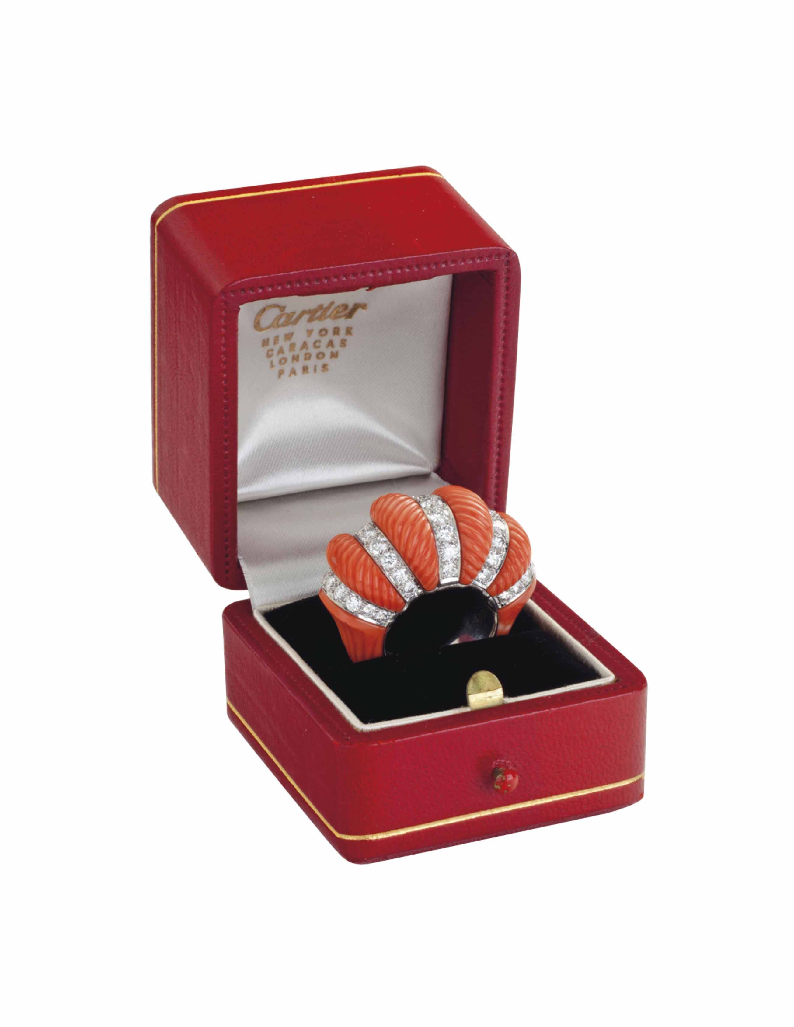 ~A CORAL AND DIAMOND RING, BY