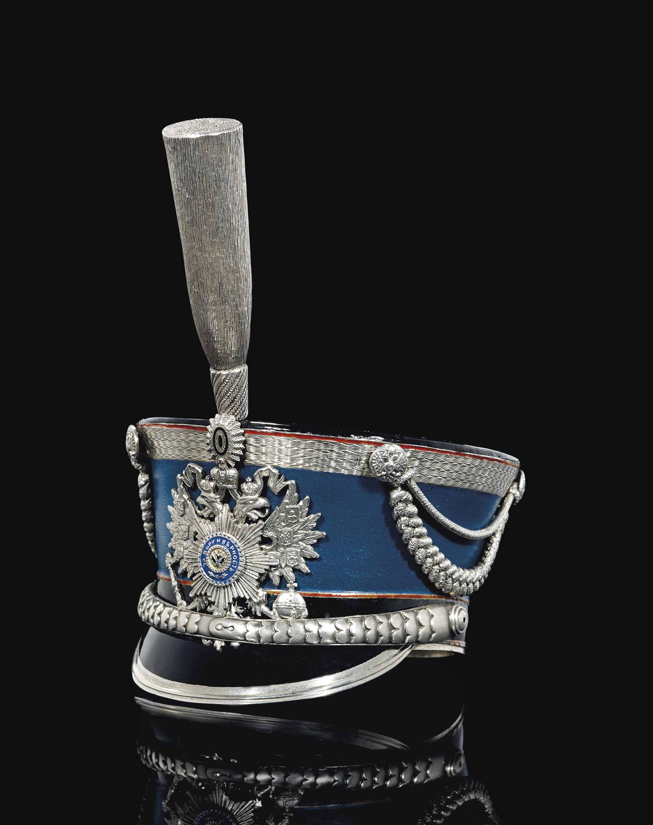 A SILVER AND ENAMEL VODKA CUP