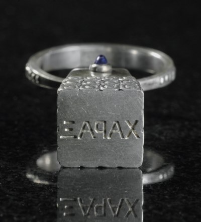A SILVER HAND-SEAL