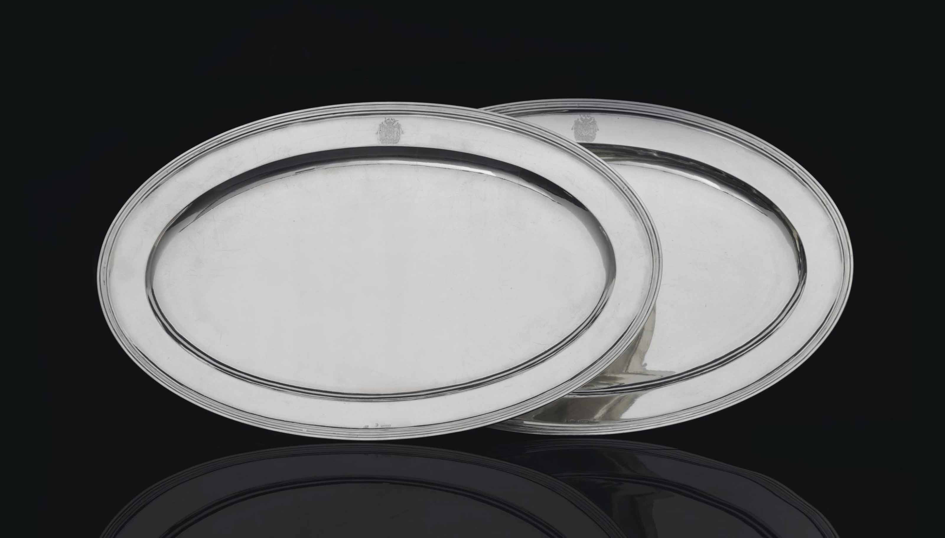 A PAIR OF SILVER SERVING PLATTERS