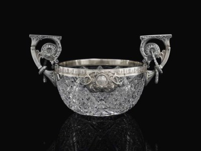 A SILVER-MOUNTED CUT-GLASS BOW