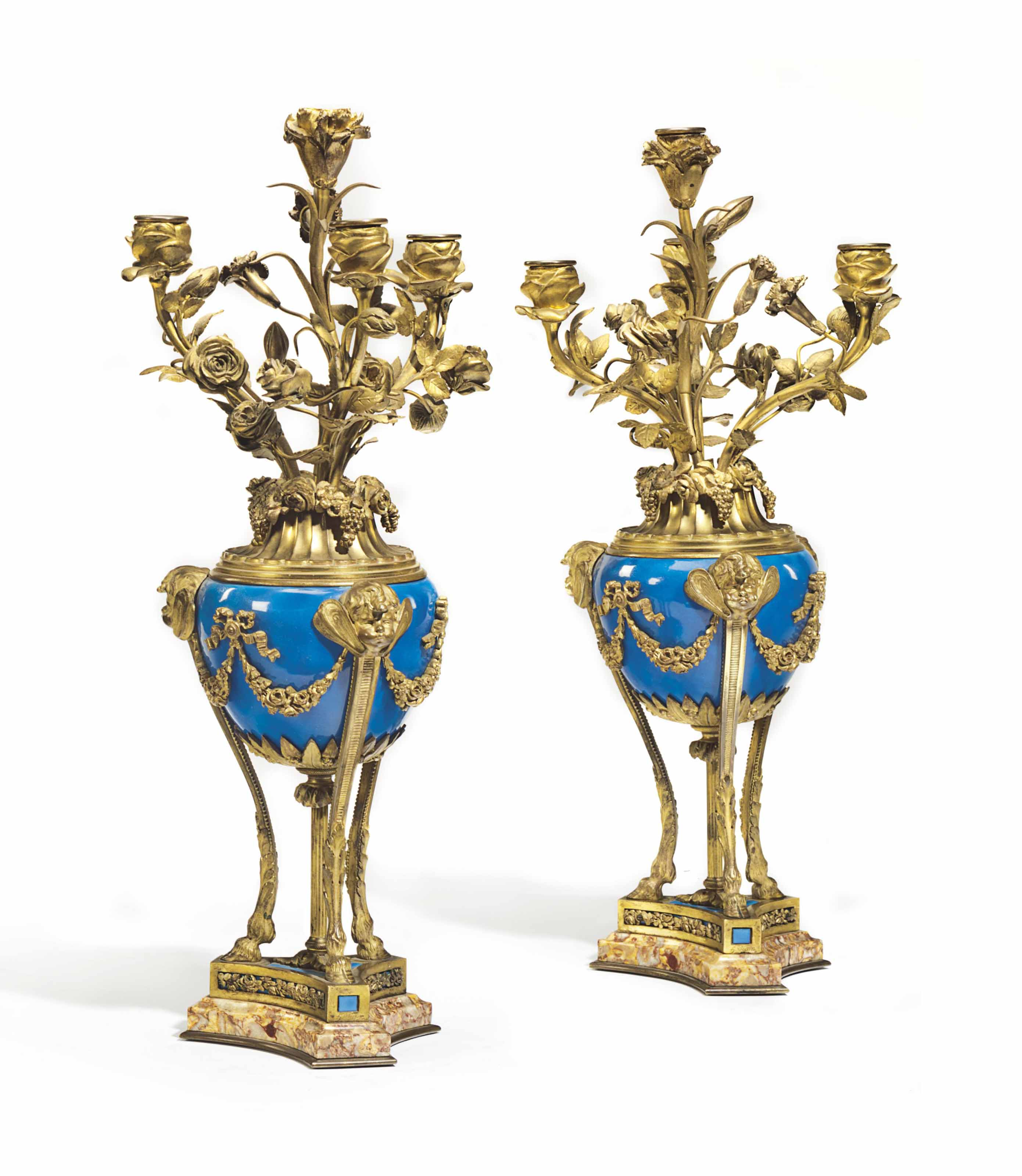 A PAIR OF A FRENCH ORMOLU-MOUNTED AND TURQUOISE-GROUND FOUR-LIGHT CANDELABRA