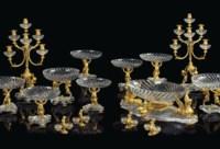 AN EXTENSIVE FRENCH ORMOLU AND CUT-CRYSTAL FIFTEEN-PIECE GARNITURE DE TABLE