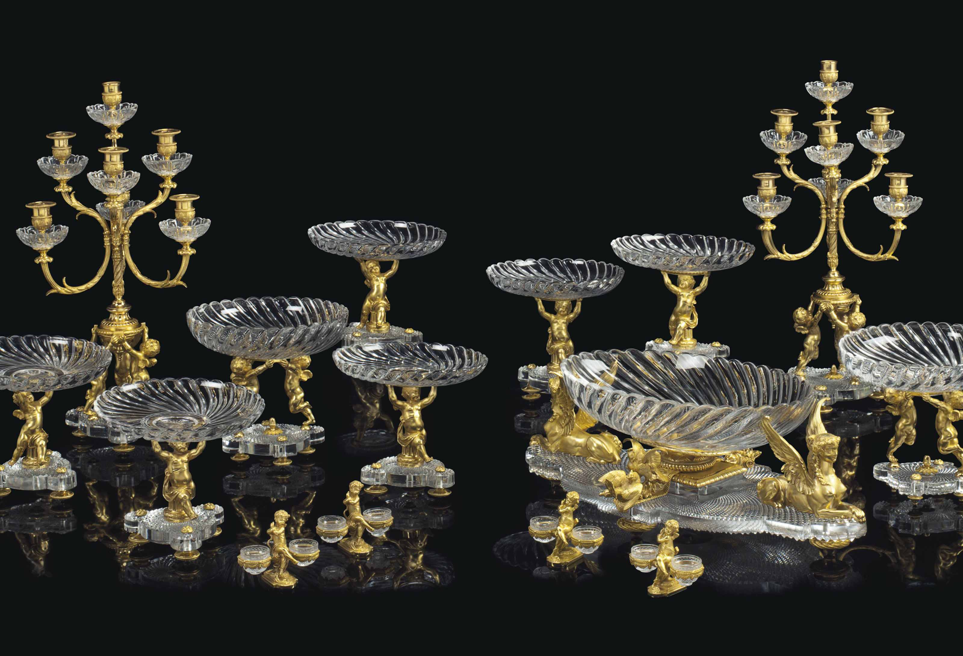AN EXTENSIVE FRENCH ORMOLU AND CUT-CRYSTAL FIFTEEN-PIECE GARNITURE DE TABLE