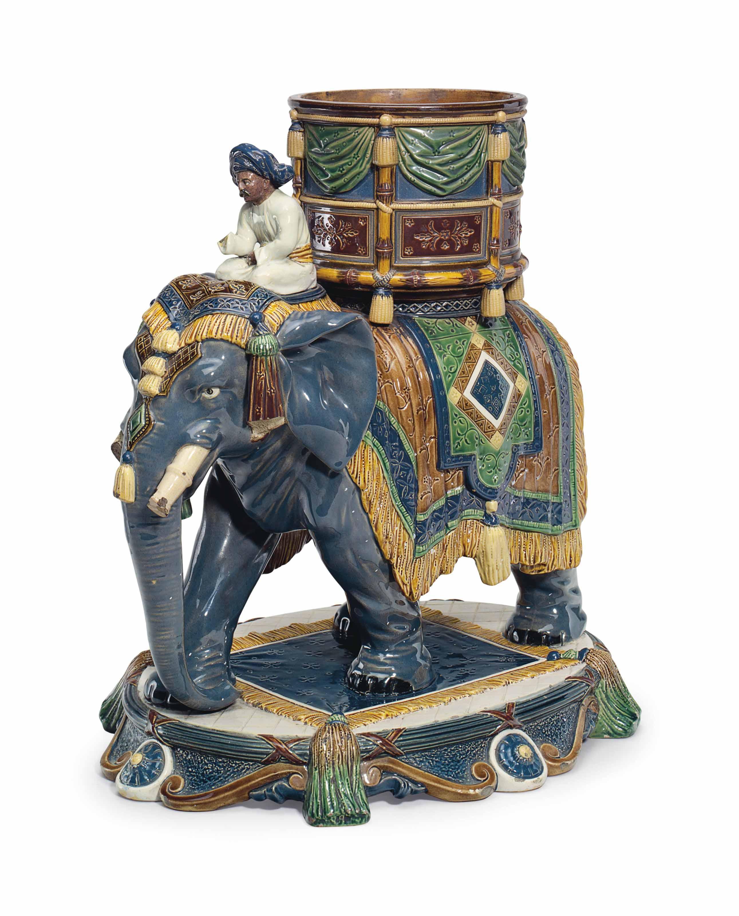 A GERBING & STEPHAN MAJOLICA ELEPHANT AND MAHOUT FORM JARDINIERE