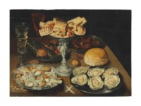 Oysters on a pewter plate with sweetmeats and biscuits in a silver tazza, chestnuts, nuts, and two façon-de-Venise wine glasses on a wooden table