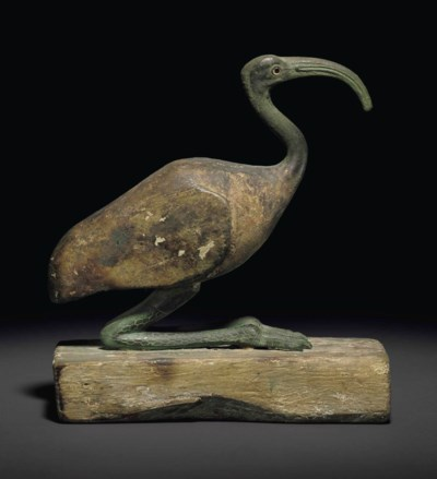 AN EGYPTIAN WOOD AND BRONZE IB