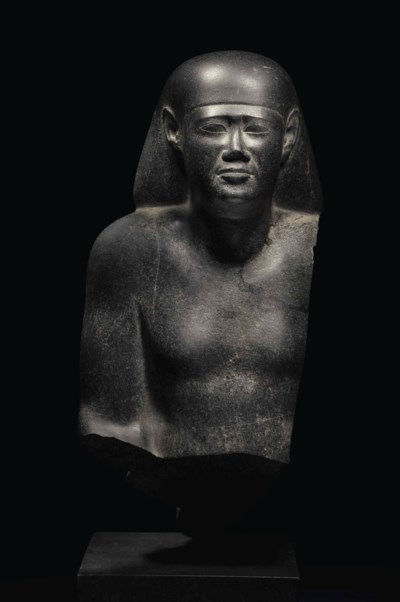 AN EGYPTIAN BLACK GRANITE BUST