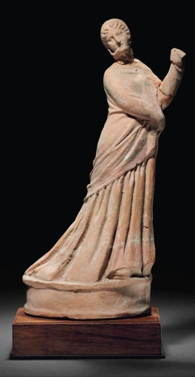 A GREEK TERRACOTTA DRAPED FEMA